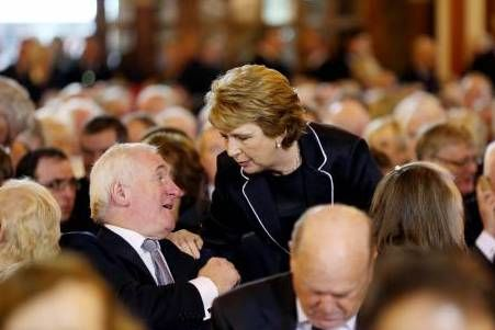 Former president Mary McAleese speak to former taoiseach Bertie Ahern at the funeral of Albert Reynolds in Donnybrook today. Photograph: Maxwell's.