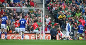 Kerry's James O'Donoghue (15) finds the net to give his side a late reprieve against Mayo.