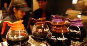 Tim Hortons employees prepare coffee in Toronto. Burger King is in talks to acquire the Canadian  chain. Photograph:  Peter Jones/Reuters