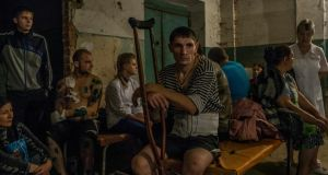 Patients and relatives gather in a hospital basement after an early-morning shelling that hit the hospital compound in central Donetsk, Ukraine. Photograph: Mauricio Lima/The New York Times