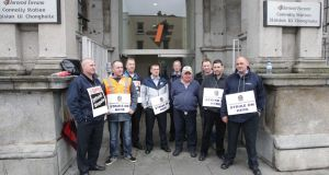Workers strike at Connolly  station yesterday. Photograph: Stephen Collins/Collins Photos