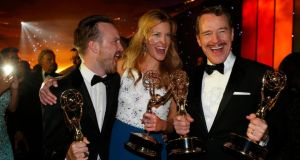 Aaron Paul, winner for Outstanding Supporting Actor in a Drama Series, Anna Gunn, winner for Outstanding Supporting Actress in a Drama Series and Bryan Cranston, winner for Outstanding Lead Actor in a Drama Series, pose with their awards for Breaking Bad during the  66th Primetime Emmy Awards in California yesterday. Photograph: Lucy Nicholson/Reuters