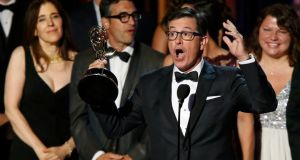 Stephen Colbert accepts the award for Outstanding Variety Series for Comedy Central's The Colbert Report.  Photograph: Mario Anzuoni/Reuters