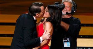 Actor Bryan Cranston engages Julia Louis-Dreyfus in a prolonged kiss as she takes the stage to accept the award for for Outstanding Lead Actress In A Comedy Series for her role in HBO's Veep. Photograph: Mario Anzuoni/Reuters