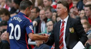 Manchester United manager Louis Van Gaal (R) shakes hands with Robin Van Persie. But another Dutch player, Daley Blind maybe in the sights of the Manchester United boss. Photograph:  REUTERS/Andrew Yates