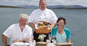 Owners Donal and Joan Kelly and head chef John Byrne pictured at the launch of Roan Carrig Restaurant at Berehaven Lodge, Castletownbere. Photograph: Emma Jervis