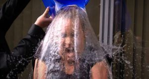 Kathryn Thomas takes the ice bucket challenge. Montessori teacher Teresina Bell knocked herself out after a similar dousing. Photograph: RTÉ
