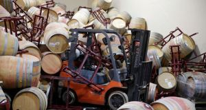 A forklift is partially buried in some of the hundreds of earthquake-damaged wine barrels at the Kieu Hoang winery in Napa, California. Photograph: AP Photo/Eric Risberg