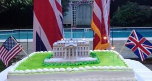 Photograph of a cake shaped like the White House together with sparklers burning and the US and British flags, as tweeted by the the British embassy in Washington.