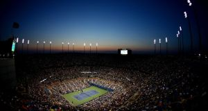 The sunsets as Roger Federer of Switzerland plays against Marinko Matosevic of Australia during their men's singles first round match on Day Two of the 2014 US Open in New York. Photograph: Streeter Lecka/Getty Images