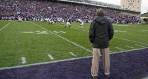 Before the fall: Joe Paterno   watches as his Penn State Nittany Lions team play Northwestern Wildcats at Ryan Field in Evanston, Illinois in 2009, three years before his  sacking over allegations he helped cover up child sexual abuse allegations against his assistant coach.  Photograph:  Jonathan Daniel/Getty Images)