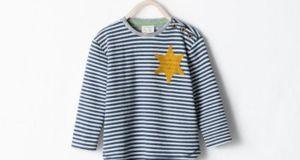 The striped long-sleeved top featuring  a golden six-pointed star that was available from the Zara.com website.