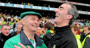 Brian McEniff celebrates with manager Jim McGuinness after Donegal's 2012 All-Ireland football final victory at Croke Park.