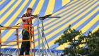 A construction worker putting together the stages for this weekend's Electric  Picnic 2014 in Stradbally, Co Laois. Photograph: Colin Keegan, Collins Dublin
