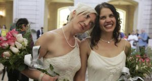 Sharon Papo (right) and Amber Weiss walk through San Francisco City Hall after exchanging wedding vows  on  June 17th, 2008. File photograph: Erin Siegal/Reuters