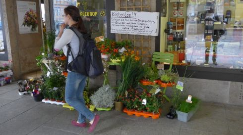 "In Erfurt, a flower shop's pitch to customers: ""Free!!! Bring us your empty balcony window boxes. We'll plant them according to your wishes and charge only for the plants and soil, no charge for the work."" Photograph: Derek Scally/The Irish Times"