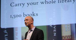 Amazon founder Jeff Bezos: 'Can you improve upon something as highly evolved and well-suited to its task as the book? And if so, how?' Photograph: Emmanuel Dunand/AFP/Getty