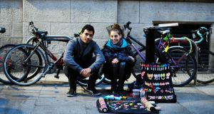 7.40pm: Juan Manuel Paniagua and Melody Padula, who sell macrame. Photograph: Aidan Crawley