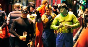 9.45pm: Catwoman, aka Newcastle fireman Lee Llewellyn, on his stag with Batman, the Flash, Mr T and the Incredible Hulk. Photograph: Aidan Crawley