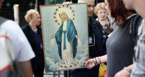 Looking at cures: pilgrims in Lourdes. Photograph: Remy Gabalda/AFP/Getty Images