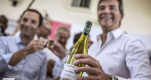 Vintage humour:  Arnaud Montebourg with his Cuvée du Redressement. Photograph: Jeff Pachoud/AFP/Getty