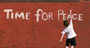 Sense of possibility: a child plays against a wall in north Belfast. Photograph: Crispin Rodwell/Reuters