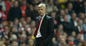 Arsene Wenger: expects to be occupied until 'final minute' of deadline day. Photograph:  Facundo Arrizabalaga/EPA