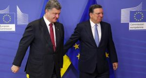 President of Ukraine Petro Poroshenko (L) is welcomed by EU Commission president Jose Manuel Barroso (R) prior to a meeting at the EU Commission headquarters in Brussels today. Photograph: EPA
