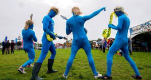 A different kind of blue: Festival-goers getting into the swing of things during day one of the Electirc Picnic Festival in Stradbally Co.Laoise. Photograph: Brenda Fitzsimons / THE IRISH TIMES