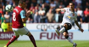 Angel di Maria of Manchester United shoots past Dean Marney of Burnley during the Premier League match  at Turf Moor. Photograph: Clive Brunskill/Getty Images