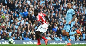 Mame Biram Diouf of Stoke City scores the only goal of the Premier League game against Manchester City at Etihad Stadium. Photograph: Shaun Botterill/Getty Images