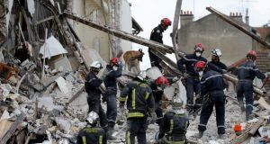 French firefighters search the rubble of a collapsed building in Rosny-Sous-Bois, near Paris today. Photograph: Christian Hartmann/Reuters.
