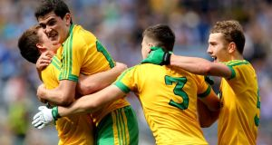 Tony McCleneghan, Stephen McBrearty, Ciarán Gillespie and Stephen McMenamin celebrate Donegal's victory over Dublin in the All-Ireland minor football semi-final at Croke Park. Photograph: Inpho.