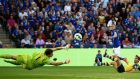 Arsenal goalkeeper Wojciech Szczesny saves from Leicester City's Jamie Vardy during the English Premier League  match at the King Power Stadium. Dylan Martinez/Reuters