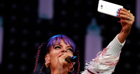 Lily Allen takes a selfie as she performs on the main stage on the last day of the Electric Picnic. Photograph: Cathal McNaughton/Reuters