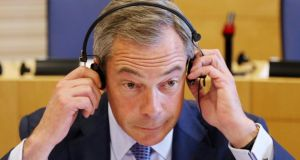 UK Independence Party (UKIP) leader Nigel Farage adjusts his headphones during a meeting of leaders of European Parliament political groups in Brussels. Prof John McCormick, of Indiana University in the US, has today said that just barely 12 per cent of eligible voters backed anti-establishment parties in May's European elections. Photograph: Francois Lenoir/Reuters.