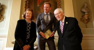 At Provost House, Trinity College, at the awarding of the Rooney Prize for Irish Literature were Patricia Rooney, the winner Colin Barrett and former US ambassador to Ireland, Dan Rooney. Photograph: Nick Bradshaw