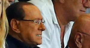 Former Italian prime minister Silvio Berlusconi watches a Italian Serie A soccer match between AC Milan and Lazio at the San Siro stadium in Milan on August 31st. Photograph: Reuters