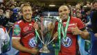 Jonny Wilkinson (left), the Toulon captain, holds  the Heineken Cup with team-mate Bryan Habana after their victory over Saracens in the last Heineken Cup final,  at the Millennium Stadium in Cardiff. The competition has been replaced this seaspon by the European Champions Cup. Photograph: David Rogers/Getty Images