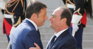'Taken together, fiscal expansion by Italy and France would represent a significant stimulus for the euro area economy (especially in combination with monetary easing by the ECB).' Above, French President François Hollande  welcomes Italy's Prime Minister Matteo Renzi before a meeting with European Socialist leaders at the Elysée Palace in Paris, last week. Christian Hartmann/Reuters