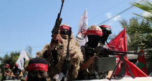 Palestinian militants from the Popular Front for the Liberation of Palestinian take part in a military display in Gaza City yesterday. Photograph: Mohammed Salem/Reuters