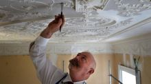 George O'Malley, restoring the plaster work by Michael Stapleton at Belvedere College Dublin. Photograph: Dara Mac Dónaill