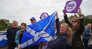 Yes and No supporters gather to listen to Jim Murphy, Shadow Secretary of State for International Development at a Better Together event in Edinburgh,Scotland. Photograph:  Getty Images/Jeff J Mitchell