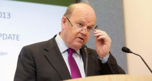 Minister for Finance Michael Noonan said the Government needed to avoid past mistakes of excessive tax cuts and spending increases. Photograph: Gareth Chaney/Collins