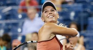 Denmark's Caroline Wozniacki celebrates defeating Italy's Sara Errani to earn a semi-final meeting with China's Peng Shuai at the US Open in New York. Photograph:  Shannon Stapleton/Reuters