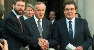 'Contrary to the insinuations of unionists and some academics that John Hume pursued an IRA ceasefire at the deliberate expense of any possible outcome from Brooke-Mayhew, the reality was that he was trying to get to a convergence of both processes.' Above, taoiseach Albert Reynolds shakes hands with Sinn Féin leader Gerry Adams and SDLP leader John Hume outside Government Buildings on September 6th 1994 after a discussion of ways to advance the peace process following the IRA's ceasefire announcement of August 31st. Photograph: Matt Kavanagh