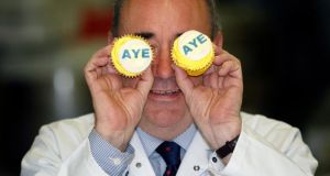 Scottish first minister and SNP leader Alex Salmond covers his eyes with cakes during a visit to Browning Bakers in Kilmarnock. Photograph: EPA/Robert Perry