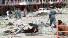 Afghan security officials inspect the site of a suicide bomb blast that targeted an intelligence office in Ghazni, Afghanistan, yesterday.  EPA/Naweed Haqjoo