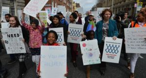 Asylum seekers, refugees and human rights supporters march from the Dáil to the Department of Justice  last yeas.  Residents  at Athlone direct provision centre say they do not receive enough food for children's lunches or dinners and that families are paying for basic items out of their weekly allowances. Photograph: David Sleator/The Irish Times