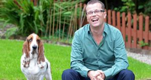 Paul Howard at home in Avoca, Co Wicklow, with his basset hound Humphrey. Photograph: Eric Luke